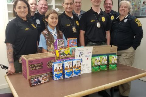 Girl Scout collects cookies for police departments | Elgin Courier